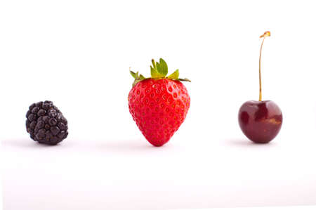 lined up: Berries lined up on an isolated white backgound