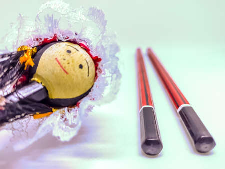 View of pencil with a beautiful doll in white background Фото со стока - 147261257