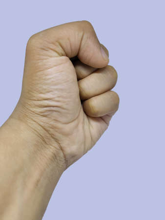 Male clenched fist, isolated on a white background Man hand with a fist. Concept of protest.
