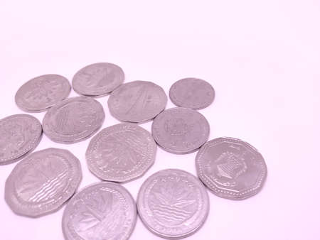 Coins of Bangladeshi currency over white background. Stock fotó