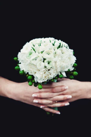bride holding a wedding bouquet made of peony