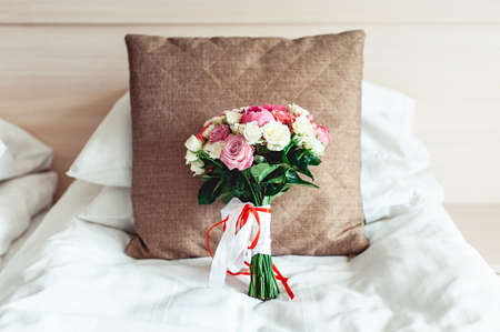 luxurious wedding bouquet on a white background on brown pillow