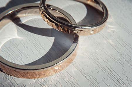 Hammered weddin rings. sunsine Stock Photo