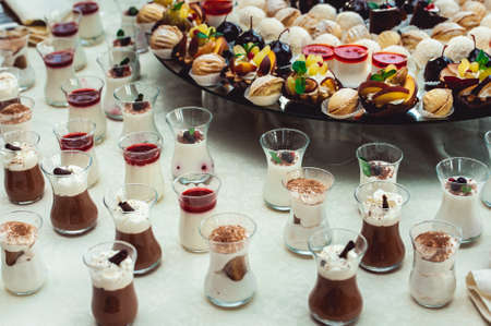 banket: Cute candy bar with various candies and cakes. Wedding sweets