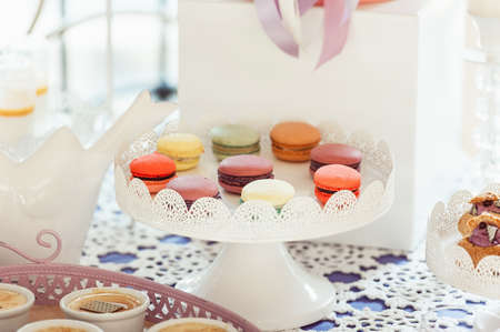 Macaroons Biscuits On White Stand.