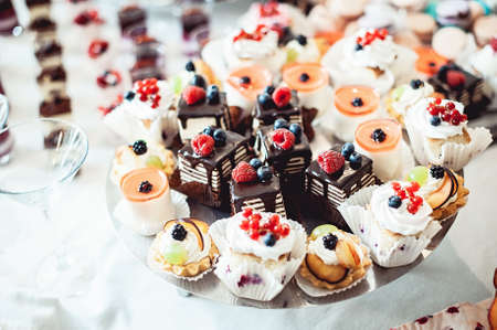 Chocolate pastries on the wedding candybar Stock Photo