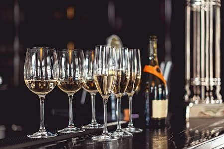 Six glasses of champagne at the bar in the restaurant