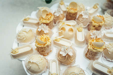 white Cakes and cupcakes on vintage white dish