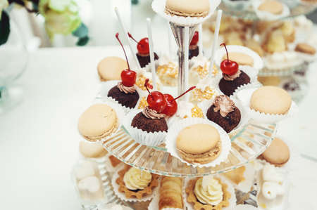 Macaroons, Biscuits, sweet baskets, On a glass stand with other bakery