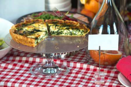 Traditional greek spinach pie, spanakopita, with goat cheese. Brunch in a restaurant
