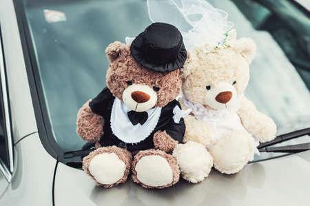 small plush bears on a wedding. Decoration on the car hood Stock Photo