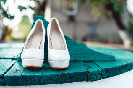 brides biege shoes on heel on a wooden board tiffany colour