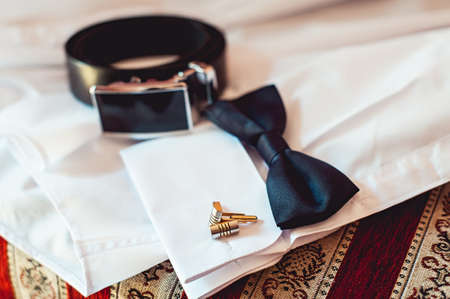 cuff link: bowtie and cufflinks on a white shirt