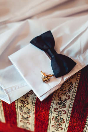 bowtie and cufflinks on a white shirt