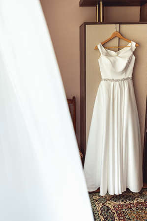 happynes: Simple white wedding dress on the rack at the wardrobe