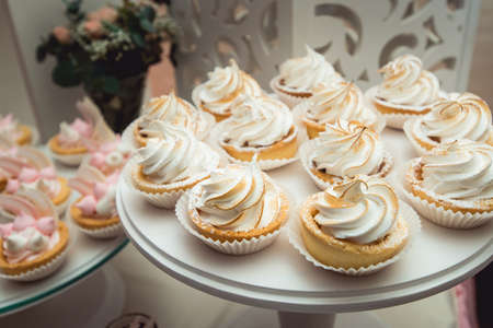 patisserie: glass stand with cupcakes on a wedding candy bar table