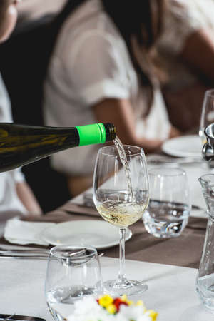 sommelier pouring wine into glass at wine and food tasting Stock Photo