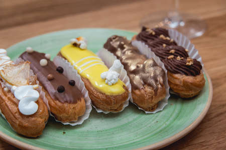 Eclairs with different ganache and icing with different toppings