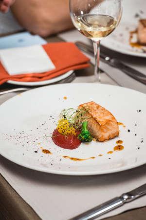 delicious salmon in a restaurant. small portion