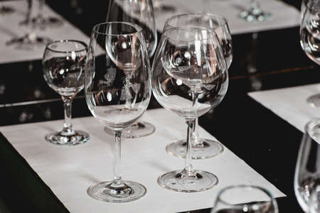 empty glasses of different shapes served for a wine tasting
