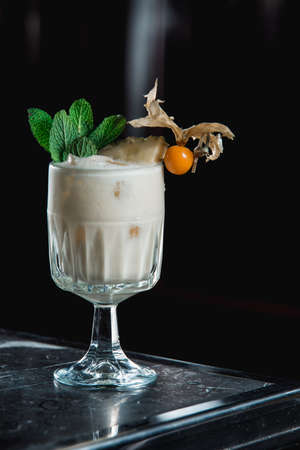 Pina Colada cocktail. exemplary tropical mixed drink with rum, pineapple and coconut drain