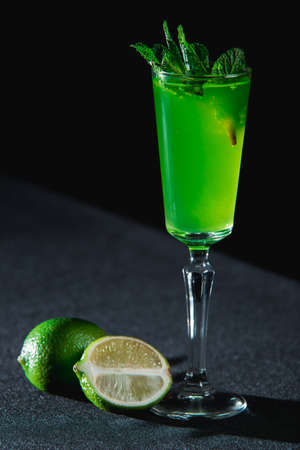 Green refreshing Alcoholic Cocktail. Mint on top