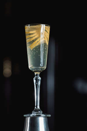 French 75 Alcoholic Cocktail garnish with a long ribbon of lemon peel