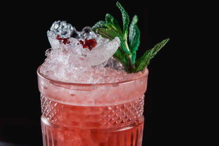 The Black Widow cocktail with pomegranate grains on top