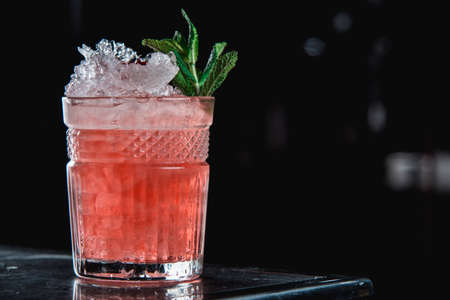 The Black Widow cocktail with pomegranate grains on top Stock Photo