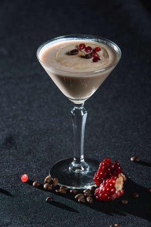 Espresso Martini cocktail, grains of pomegranate on top Archivio Fotografico