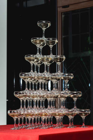 Big champagne tower on a red table