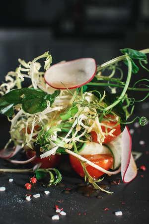 fresh organik salad on a round stone plate.