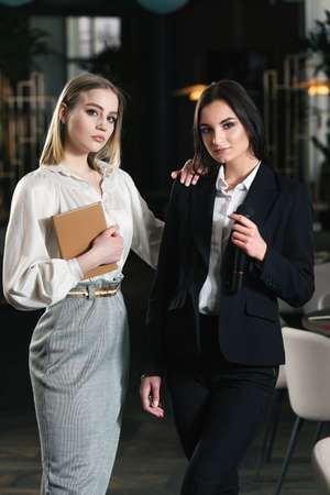 Business and speech topic: two women standing together Stock Photo
