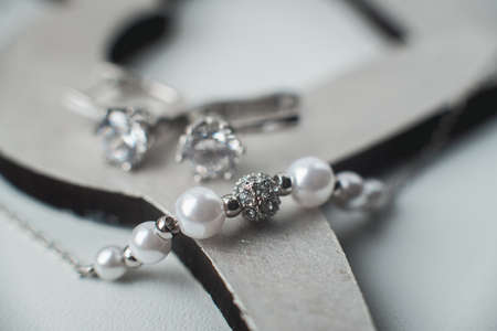 close-up macro photo pearl diamond necklace. earrings with pearls