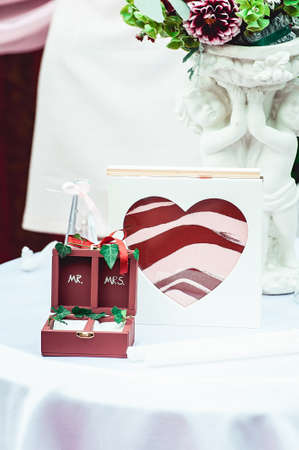 colored sand in the bottle, heart shaped. Wedding ceremony. Decorative box for rings
