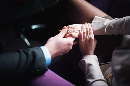 Bride and groom holding hands Wedding day Imagens