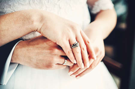 Bride and groom holding hands. Wedding day Imagens