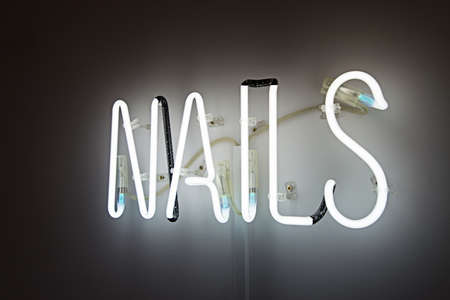 Shining Nails white Neon Label. advertising for a beauty salon