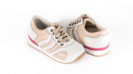 childrens beige orthopedic shoes on a white background Foto de archivo