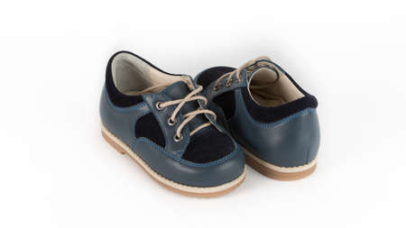 childrens blue orthopedic shoes on a white background Foto de archivo