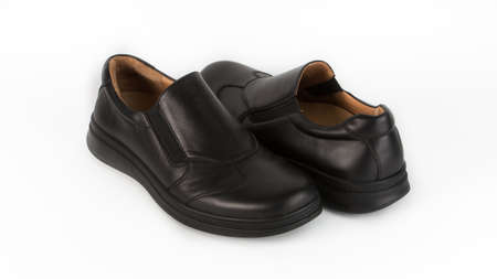 childrens black orthopedic shoes on a white background
