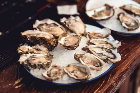 Opened Oysters Fines de Claire on plate with ice