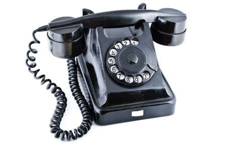old office: Black old phone isolated on white background Stock Photo