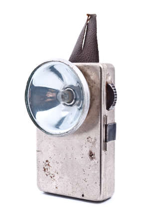 torchlight: Old rusty pocket flashlight isolated on white background