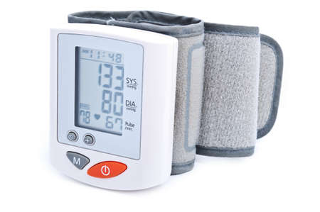 Modern digital blood pressure measurement equipment isolated on a white background photo