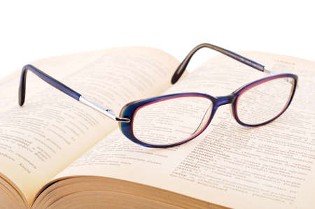 writing on glass: A pair of glasses on a book concepts of knowledge and education