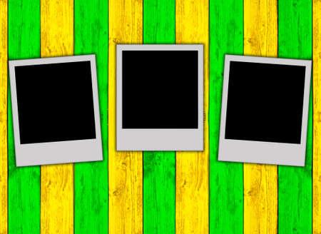Three Blank Photos on Multicolored Wood Background photo