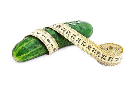 scrawny: cucumber with a measuring tape isolated on white background