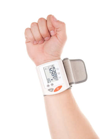 Man's hand with modern digital blood pressure measurement equipment isolated on a white background