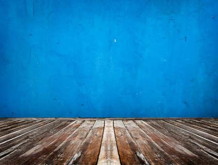 blue empty room with wooden floor photo